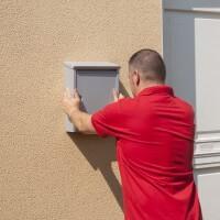 To bond mailboxes onto walls